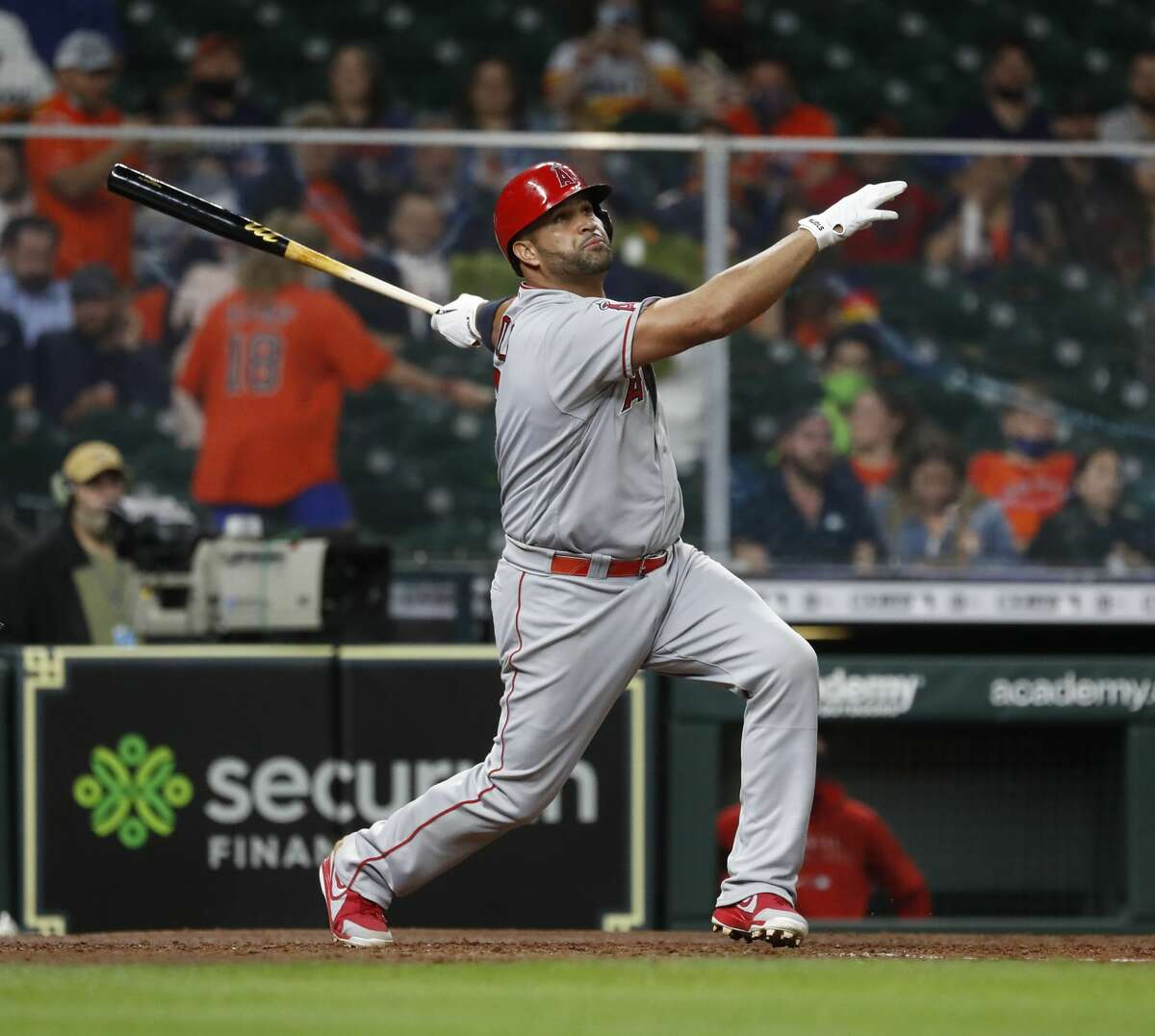 Los Angeles Angels Albert Pujols (5) hits a two-run home run off of Houston Astros pitcher Bryan Abreu during the sixth inning of an MLB baseball game at Minute Maid Park, Thursday, April 22, 2021, in Houston.