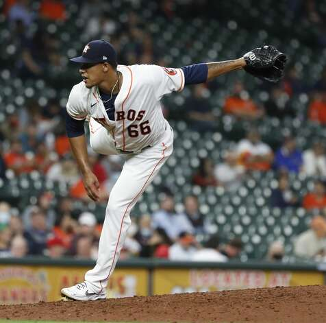 Houston Astros relief pitcher Bryan Abreu (66) pitches during the sixth inning of an MLB baseball game at Minute Maid Park, Thursday, April 22, 2021, in Houston. Photo: Karen Warren/Staff Photographer / @2021 Houston Chronicle