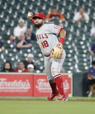 Los Angeles Angels third baseman Jose Rojas (18) makes the throw to first base as Houston Astros Yuli Gurriel ground out during the fourth inning of an MLB baseball game at Minute Maid Park, Thursday, April 22, 2021, in Houston. Photo: Karen Warren/Staff Photographer / @2021 Houston Chronicle