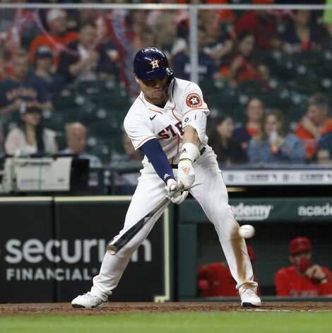Houston Astros Aledmys Diaz (16) reaches on a fielder's choice during the fourth inning of an MLB baseball game at Minute Maid Park, Thursday, April 22, 2021, in Houston. Photo: Karen Warren/Staff Photographer / @2021 Houston Chronicle