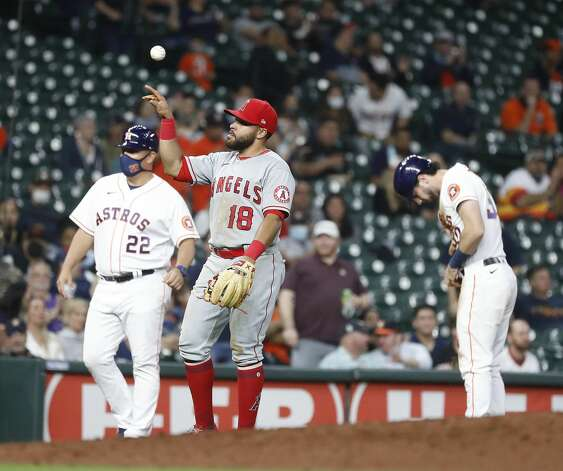 Los Angeles Angels third baseman Jose Rojas (18) reacts after Houston Astros Kyle Tucker (30) reaches third base as Aledmys Diaz hit into a fielder's choice during the fourth inning of an MLB baseball game at Minute Maid Park, Thursday, April 22, 2021, in Houston. Photo: Karen Warren/Staff Photographer / @2021 Houston Chronicle