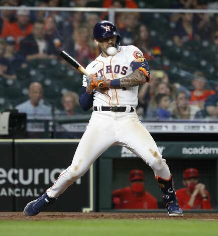 Houston Astros Carlos Correa (1) leans back from a pitch inside from Los Angeles Angels relief pitcher Junior Guerra (41) during the fifth inning of an MLB baseball game at Minute Maid Park, Thursday, April 22, 2021, in Houston. Photo: Karen Warren/Staff Photographer / @2021 Houston Chronicle