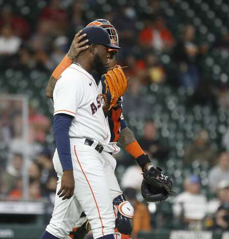 Houston Astros catcher Martin Maldonado (15) wraps his hand around starting pitcher Cristian Javier's head as they chat after Los Angeles Angels Jared Walsh's single during the fourth inning of an MLB baseball game at Minute Maid Park, Thursday, April 22, 2021, in Houston. Photo: Karen Warren/Staff Photographer / @2021 Houston Chronicle