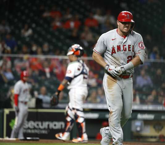 Los Angeles Angels Mike Trout (27) grimaces in pain after getting hit by a pitch from Houston Astros starting pitcher Cristian Javier (53) during the fourth inning of an MLB baseball game at Minute Maid Park, Thursday, April 22, 2021, in Houston. Photo: Karen Warren/Staff Photographer / @2021 Houston Chronicle