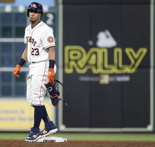 Houston Astros Michael Brantley (23) stands on second base after his ground rule double during the third inning of an MLB baseball game at Minute Maid Park, Thursday, April 22, 2021, in Houston. Photo: Karen Warren/Staff Photographer / @2021 Houston Chronicle