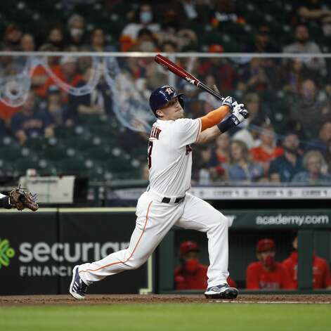 Houston Astros Myles Straw (3) hits a triple during the second inning of an MLB baseball game at Minute Maid Park, Thursday, April 22, 2021, in Houston. Photo: Karen Warren/Staff Photographer / @2021 Houston Chronicle