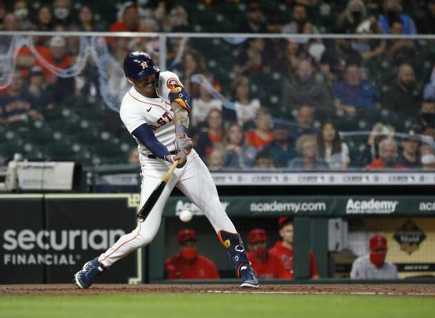 Houston Astros shortstop Carlos Correa (1) hits an RBI single during the second inning of an MLB baseball game at Minute Maid Park, Thursday, April 22, 2021, in Houston. Photo: Karen Warren/Staff Photographer / @2021 Houston Chronicle