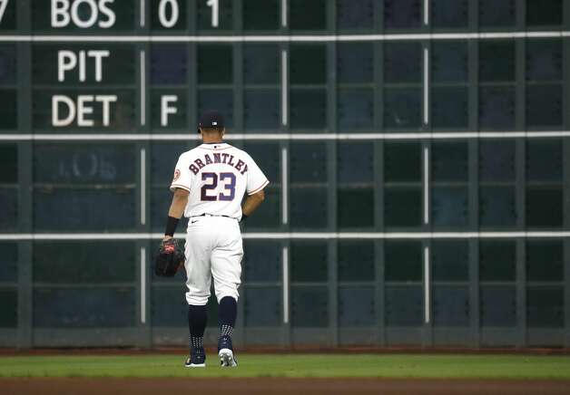 Houston Astros left fielder Michael Brantley (23) walks out to his spot with his pants hiked up, as he normally wears his down, during the first inning of an MLB baseball game at Minute Maid Park, Thursday, April 22, 2021, in Houston. Photo: Karen Warren/Staff Photographer / @2021 Houston Chronicle