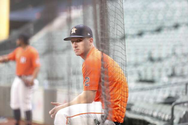 Houston Astros Alex Bregman sits next to the netting before warming up during batting practice before the start of an MLB baseball game at Minute Maid Park, Thursday, April 22, 2021, in Houston. Photo: Karen Warren/Staff Photographer / @2021 Houston Chronicle