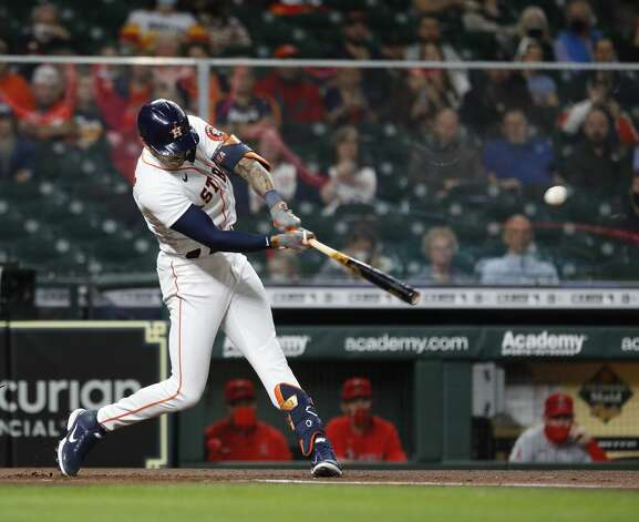 Houston Astros lead off hitter Carlos Correa (1) lines out during the first inning of an MLB baseball game at Minute Maid Park, Thursday, April 22, 2021, in Houston. Photo: Karen Warren/Staff Photographer / @2021 Houston Chronicle