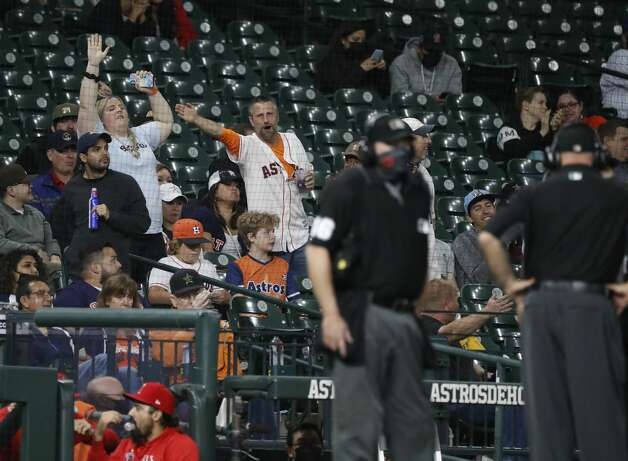 Houston Astros fans react as umpires review Los Angeles Angels Albert Pujols'two-run home during the sixth inning of an MLB baseball game at Minute Maid Park, Thursday, April 22, 2021, in Houston. Photo: Karen Warren/Staff Photographer / @2021 Houston Chronicle
