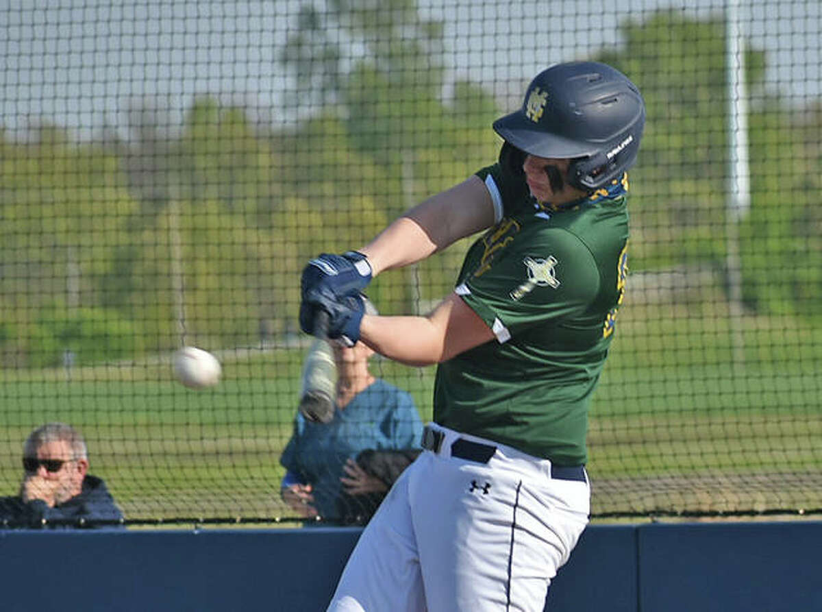 Father McGivney's Gabe Smith rips an RBI single into center field in the first inning against East Alton-Wood River on Thursday in Glen Carbon.