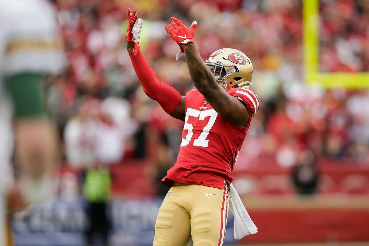 San Francisco 49ers' Dre Greenlaw tries to get the crowd louder in the first quarter during the NFC Championship game between the San Francisco 49ers and the Green Bay Packers at Levi's Stadium on Sunday, Jan. 19, 2020 in Santa Clara, Calif.