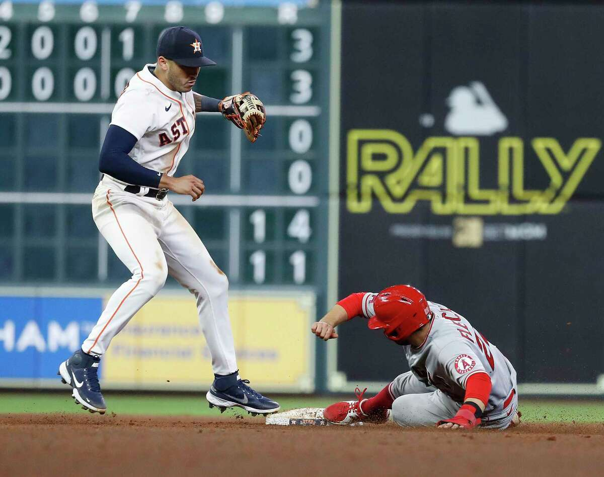 Astros shortstop Carlos Correa tags out David Fletcher at second base after Shohei Ohtani grounded into a force out during the seventh inning. The Angels scored their only runs in the top of the sixth.