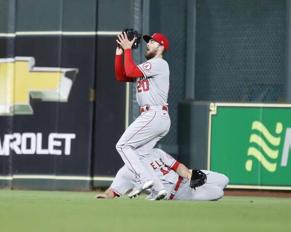 Los Angeles Angels first baseman Jared Walsh (20) catches Houston Astros Yuli Gurriel's line out during the eighth inning of an MLB baseball game at Minute Maid Park, Thursday, April 22, 2021, in Houston. Photo: Karen Warren/Staff Photographer / @2021 Houston Chronicle
