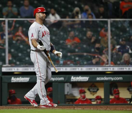 Los Angeles Angels Albert Pujols (5) strikes out against Houston Astros relief pitcher Joe Smith (38) during the eighth inning of an MLB baseball game at Minute Maid Park, Thursday, April 22, 2021, in Houston. Photo: Karen Warren/Staff Photographer / @2021 Houston Chronicle