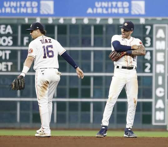 Houston Astros Aledmys Diaz (16) and Carlos Correa (1) celebrate after the Astros beat the Los Angeles Angels 8-2 during an MLB baseball game at Minute Maid Park, Thursday, April 22, 2021, in Houston. Photo: Karen Warren/Staff Photographer / @2021 Houston Chronicle