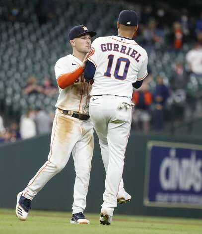 Houston Astros third baseman Alex Bregman (2) and Yuli Gurriel (10) celebrate after the Astros beat the Los Angeles Angels 8-2 during an MLB baseball game at Minute Maid Park, Thursday, April 22, 2021, in Houston. Photo: Karen Warren/Staff Photographer / @2021 Houston Chronicle