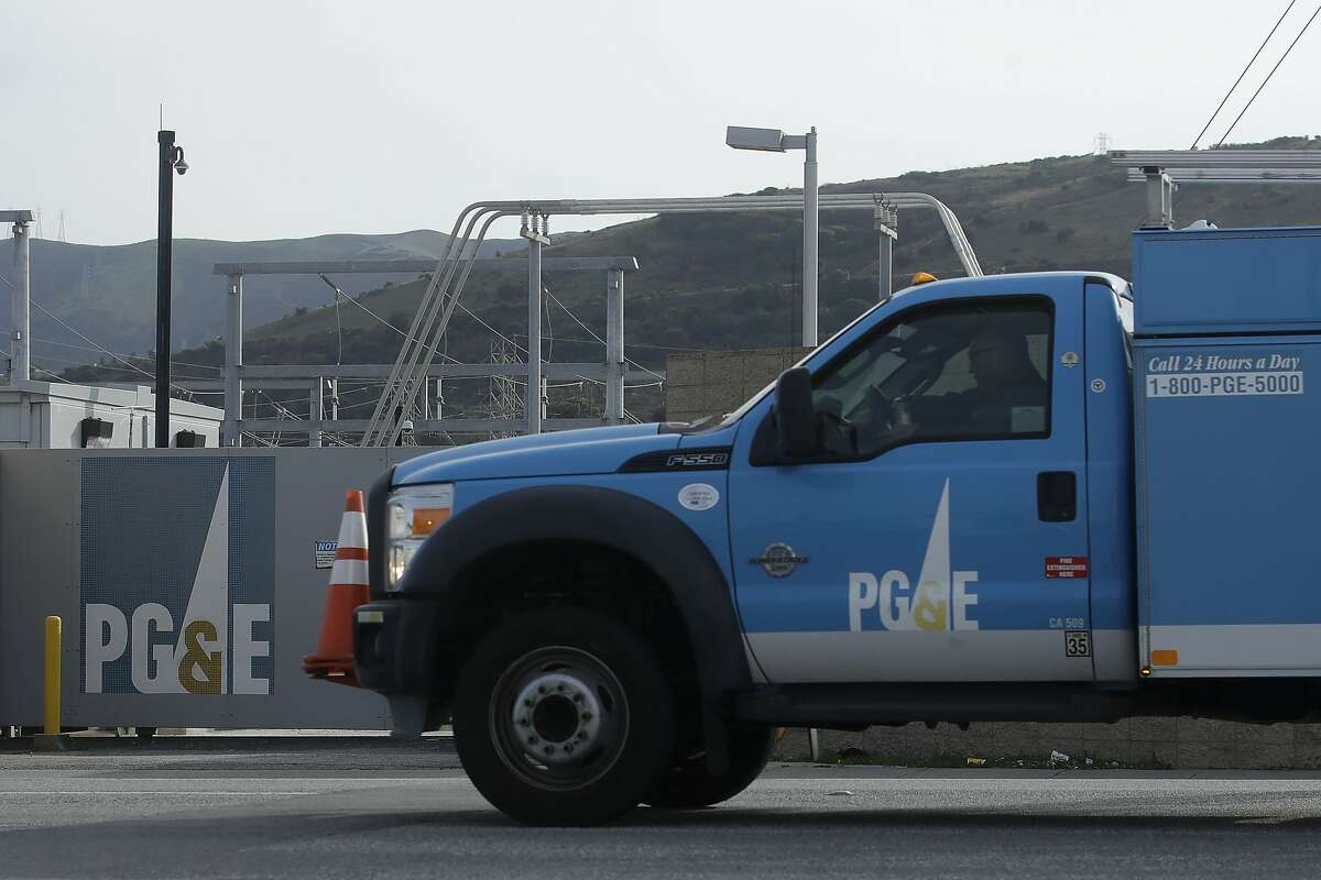 FILE - In this Feb 20, 2020, file photo, a Pacific Gas and Electric truck drives past a PG&E location in San Francisco. (AP Photo/Jeff Chiu, File)