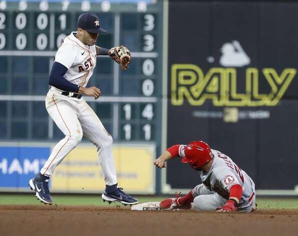 Houston Astros shortstop Carlos Correa (1) tags Los Angeles Angels David Fletcher (22) out at second base as Shohei Ohtani ground into a force out during the seventh inning of an MLB baseball game at Minute Maid Park, Thursday, April 22, 2021, in Houston. Photo: Karen Warren/Staff Photographer / @2021 Houston Chronicle