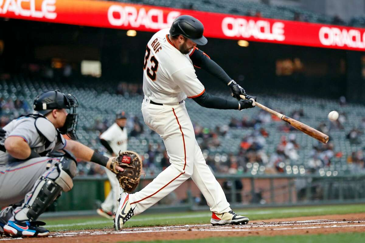 San Francisco Giants' Darin Ruf strokes an RBI double against Miami Marlins during 1st inning of MLB game at Oracle Park in San Francisco, Calif., on Thursday, April 22, 2021.