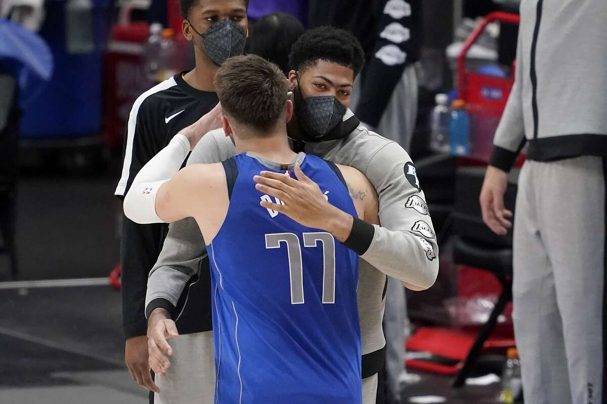 Dallas Mavericks' Luka Doncic (77) and Los Angeles Lakers' Anthony Davis greet each other after an NBA basketball game in Dallas, Thursday, April 22, 2021. (AP Photo/Tony Gutierrez)