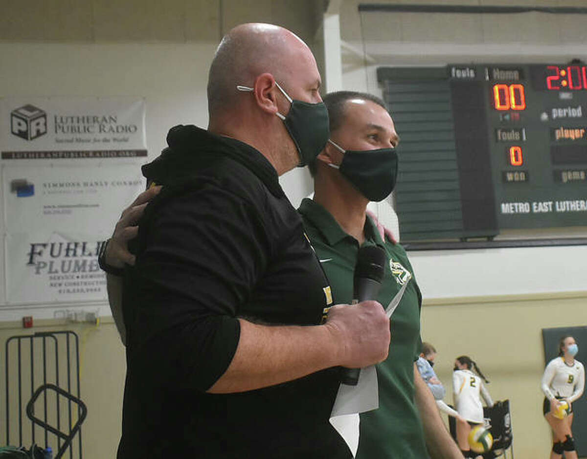 Metro-East Lutheran girls volleyball coach Jon Giordano, right, and athletic director Jason Batty joke around before the start of the match against Father McGivney on Monday.