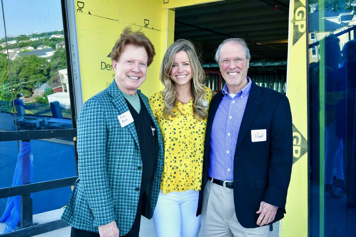 Dr. Mike Mann, Brandy Bellow Spinks, Randall Turner attend the topping out ceremony for Museo Medical Office Building, 5115 Fannin Street.
