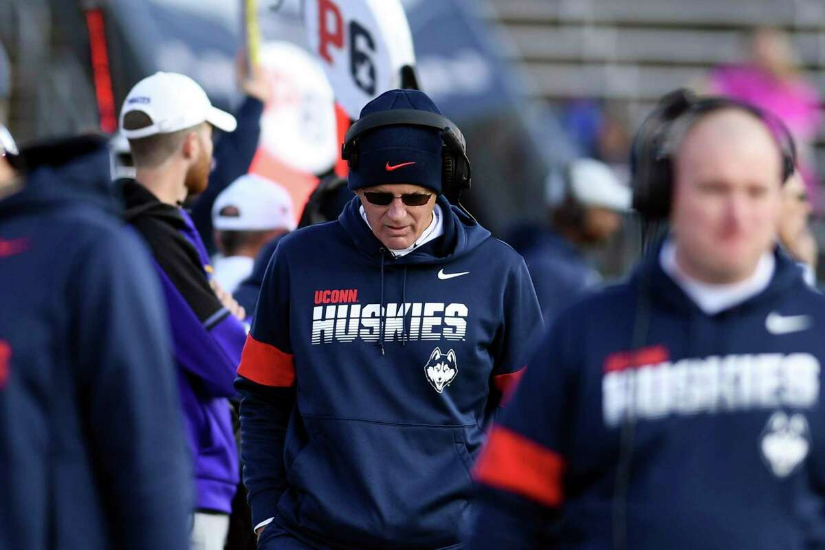 UConn football coach Randy Edsall walks the sidelines duringv a 2019 home game in East Hartford.
