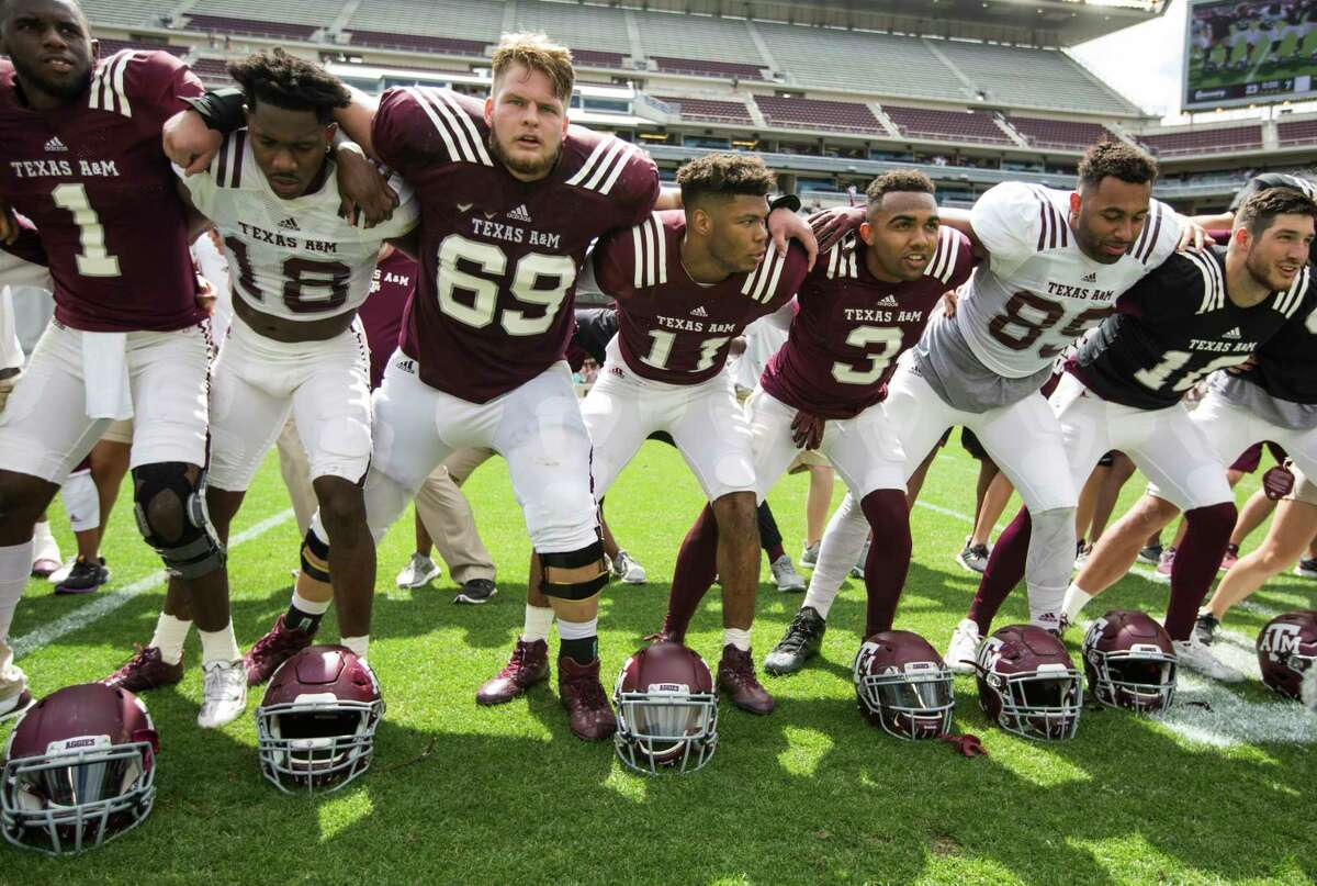 The Texas A&M football team gather on the field to sing following the Texas A&M spring football game at Kyle Field on Saturday, April 8, 2017, in College Station.
