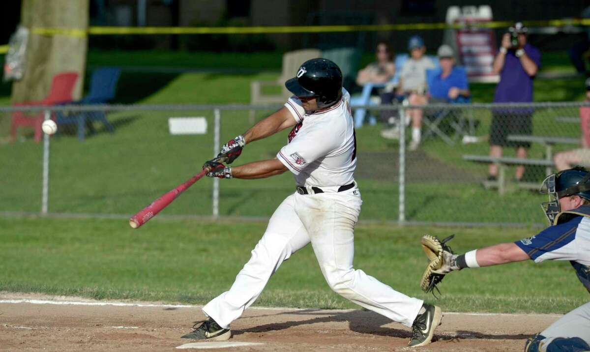 Vinny Bailey (18), from North Carolina University, drives a ball to deep left-center during the Danbury Westerners game with the Mystic Schooners, Tuesday night. July 2, 2019, in Danbury, Conn.