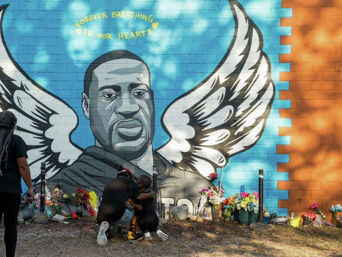 People visit a George Floyd mural near Cuney Homes, following the guilty verdict on all counts in the murder trial of former Minneapolis Officer Derek Chauvin, on Tuesday, April 20, 2021, in Third Ward, Houston.