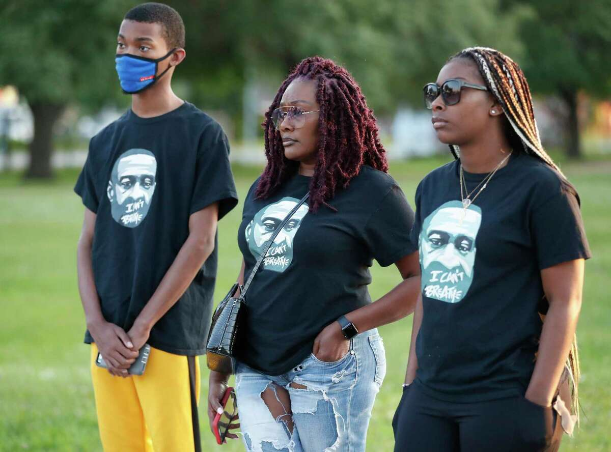 People wearing George Floyd t-shirts during a vigil at MacGregor Park after they learned the guilty verdict on all counts in the murder trial of former Minneapolis Officer Derek Chauvin in the death of George Floyd on Tuesday, April 20, 2021, in Houston.