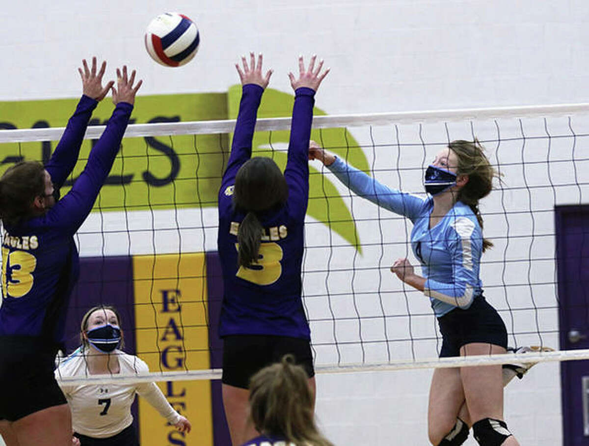 Jersey's Kari Krueger (right) hits past the block put up by CM in a MVC match earlier this season in Bethalto. The Panthers closed their spring volleyball season Thursday night with a win over Southwestern in Jerseyville.