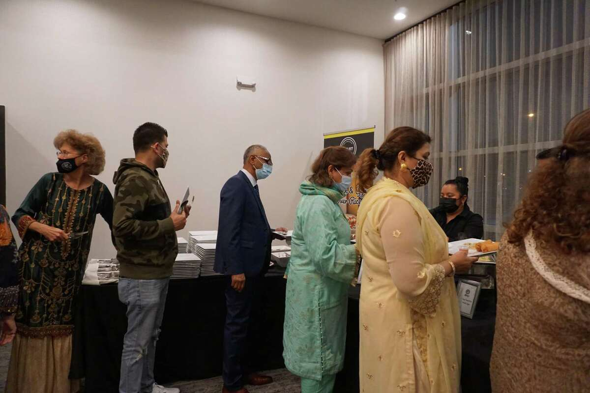 Attendees stand in line for the buffet at the Fort Bend Iftar on Friday, April 16, at the Aloft Hotel in Katy.