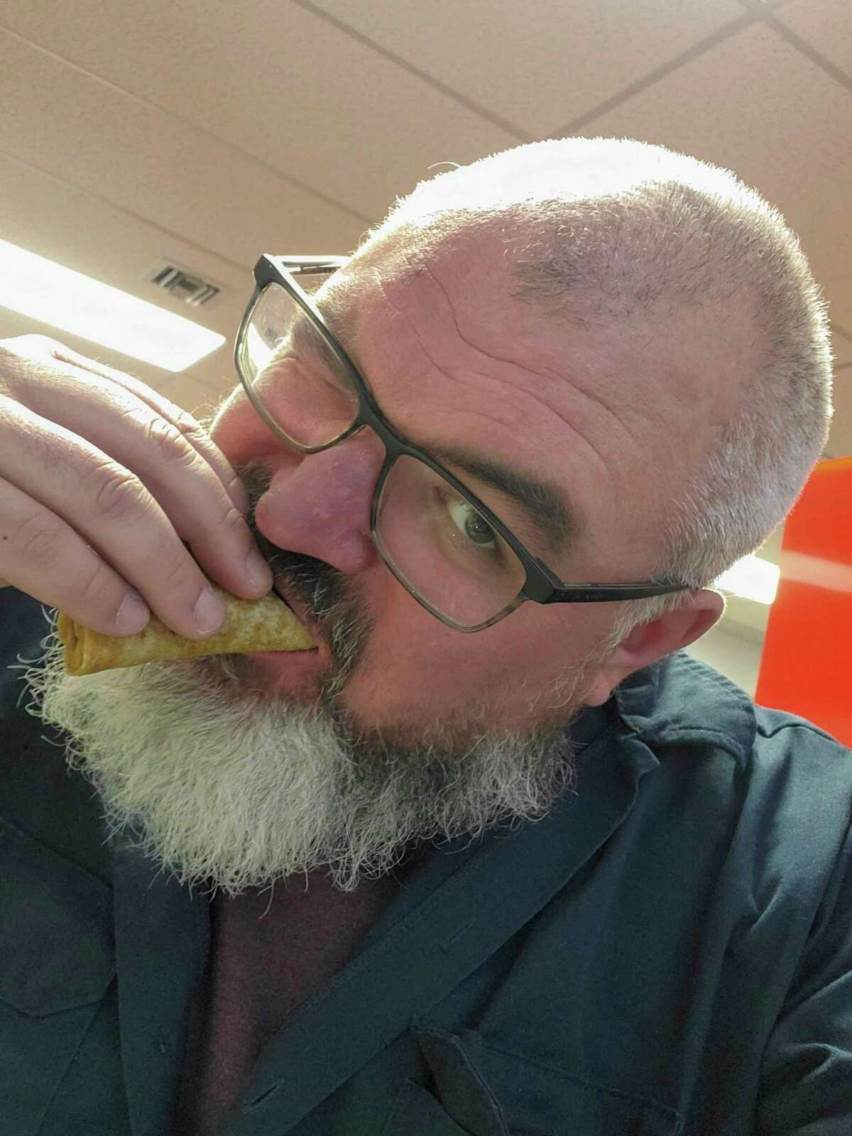 Apparently when taking a bite of a street taco, you do so with only one eye open. (Scott Nunn/Huron Daily Tribune)