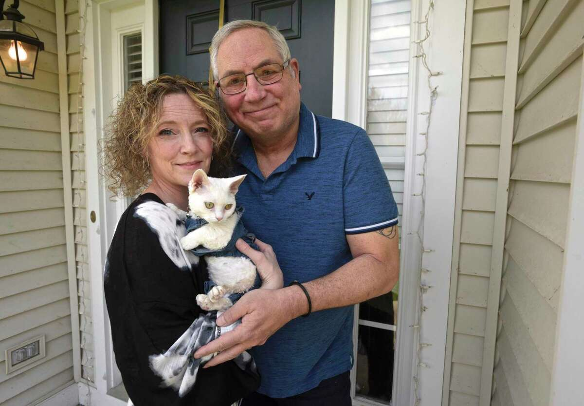 Stephanie Lyons-Keeley and her husband Wayne Keely with their kitten Luke who they adopted after the death of Wayne's son, Wyatt, in December 2020. Tuesday, April 20, 2021 in Danbury, Conn.