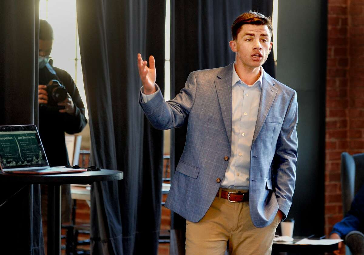 Luke Deakos of Father McGivney Catholic High Schools gives his presentation in front of judges during the Edwardsville CEO Fish Tank Thursday at the Ink House. Deakos would go on to be the first prize winner.