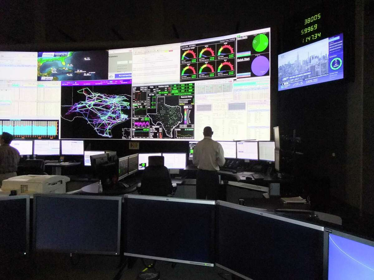 Workers in in the control room of the Electric Reliability Council of Texas, which operates most of the state's power grid, must keep a balance between electric generation and demand to prevent transmission lines from overloading.