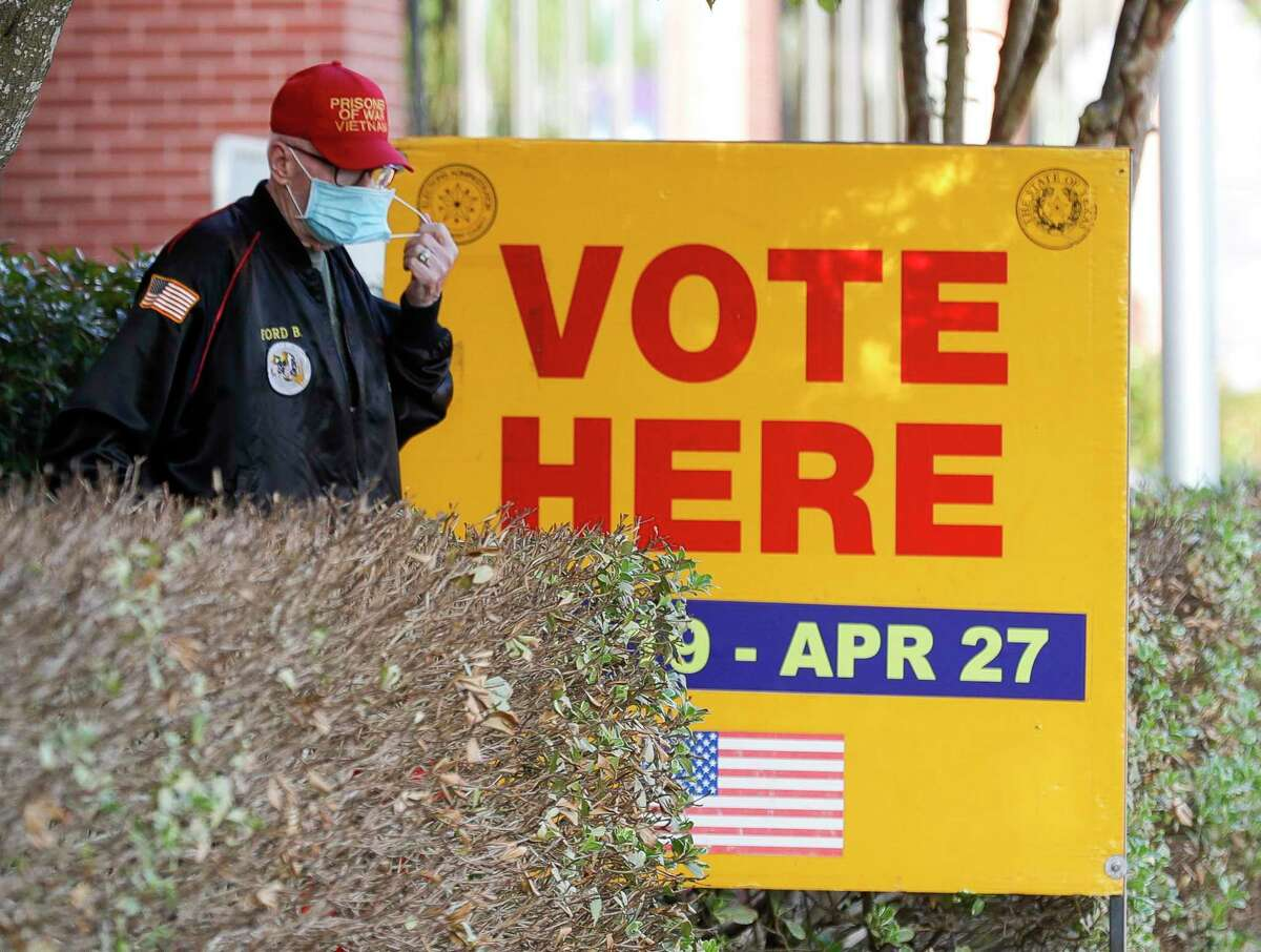 A man removes his face mask after voting on the second day of early voting for the May election, Tuesday, April 20, 2021, in Conroe. The election will cover various propositions along with city positions including, council members and school district trustees for different Montgomery County areas.