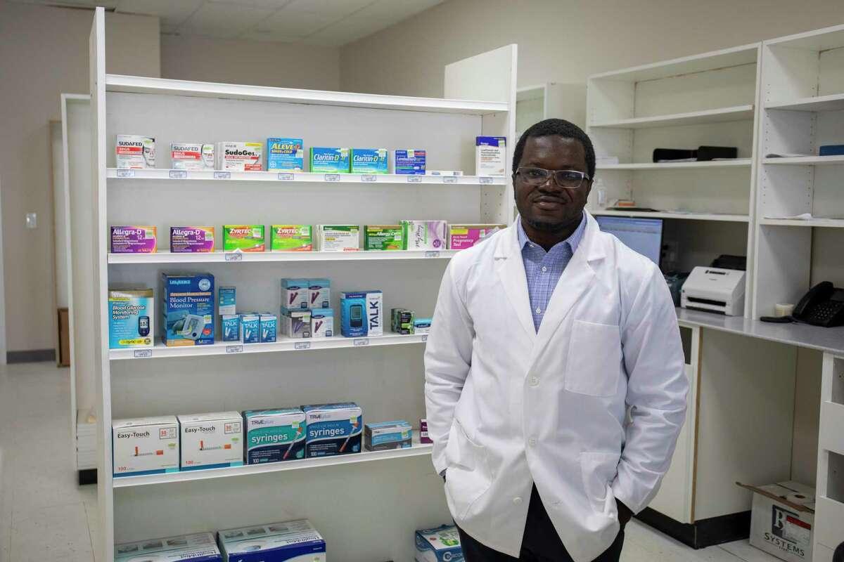 Pharmacist Setor Akati poses for a portrait Tuesday, April 20, 2021 at Doctor???s Pharmacy. Jacy Lewis/Reporter-Telegram