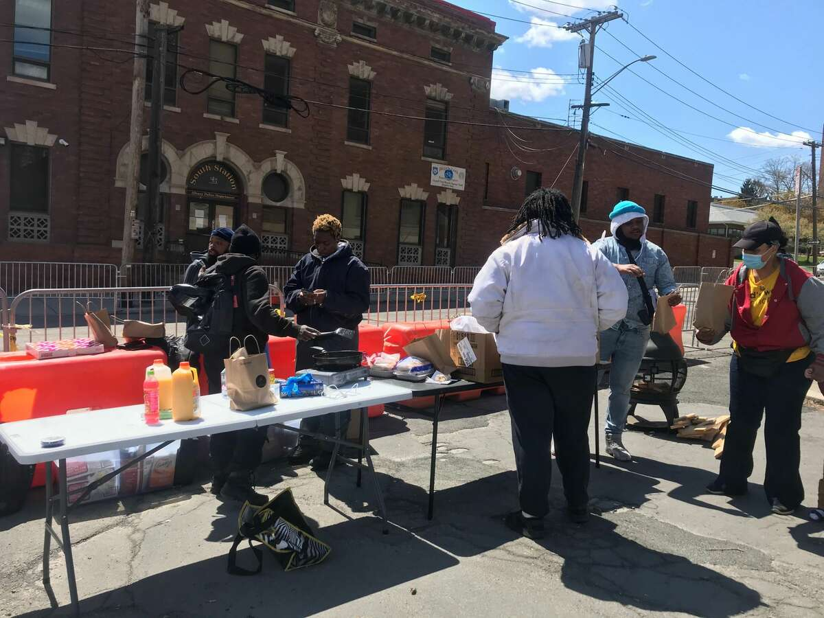 A day after Albany police cleared an encampment of demonstrators from an an encampment next to South Station station, demonstrators returned Friday to prepare meals for anyone visiting the site.next to the station.