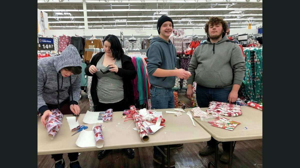 Ascent students wrap gifts for the Shop with a Hero program. (Kelly Durr/Courtesy Photo)