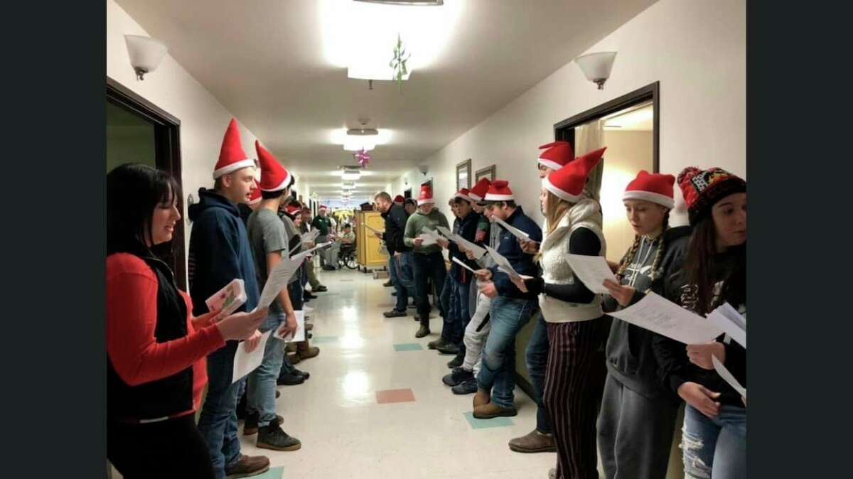 Ascent High School Students sing Christmas Carols at Courtney Manor in a past service project. The students normally engage in several service projects a year, including helping plant trees along the Bad Axe Walking Path this coming Monday. (Kelly Durr/Courtesy Photo)
