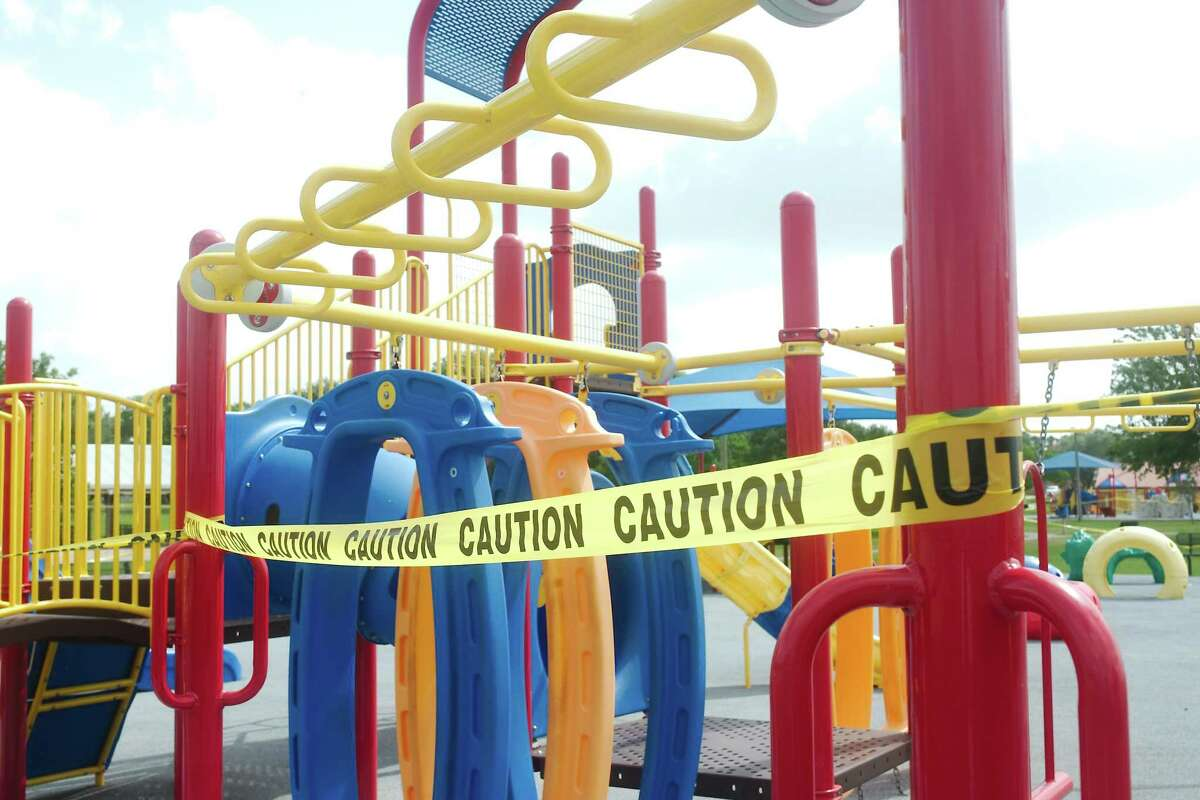 Police caution tape prevents access to the playground equipment at Clear Lake Park during the COVID-19 pandemic last July 8.
