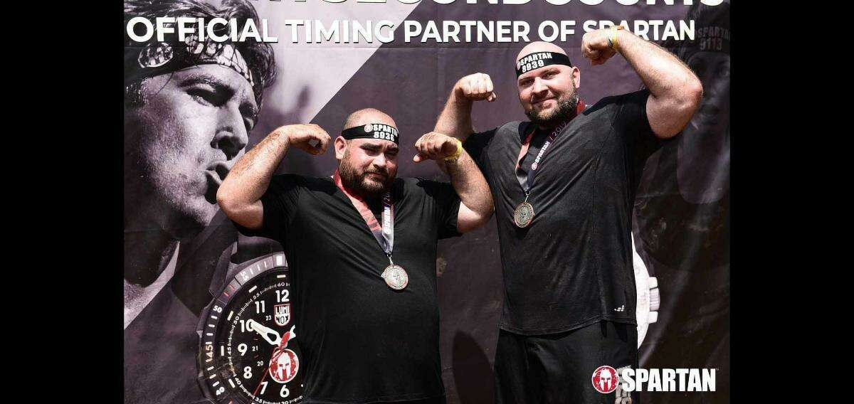 Harris County Sheriff's Dep. Alexander Gwosdz, who died Wednesday from complications related to COVID-19. He is pictured here with Joshua Wilson, a close friend, when the two participated in a Spartan race together in 2019.