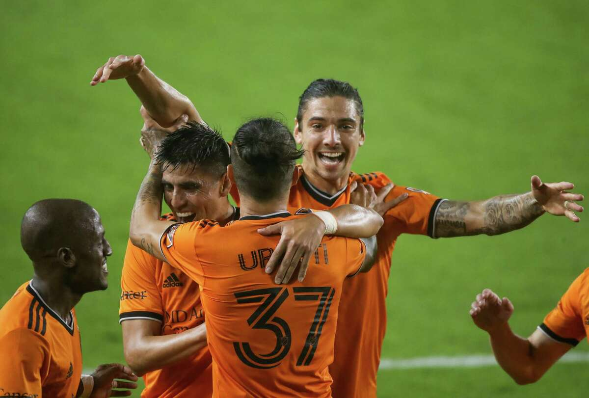 The Dynamo could celebrate after winning their opener. Forward Maximiliano Urruti (37) is hugged by teammates after scoring in the 2-1 victory over San Jose.