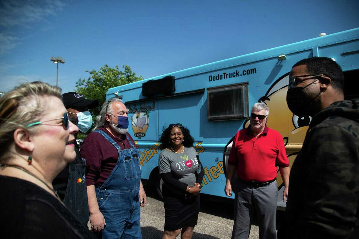 (Left to right) Laura Parks, Lawrence Walker, John Parks, Robertine Jefferson, Jeff Parks and Lucille's 1913 Chef Chris Williams talk after the Parks family donated to Lucille's 1913 their food truck in memory of their son Jesse Parks, Thursday, April 22, 2021, in Houston.