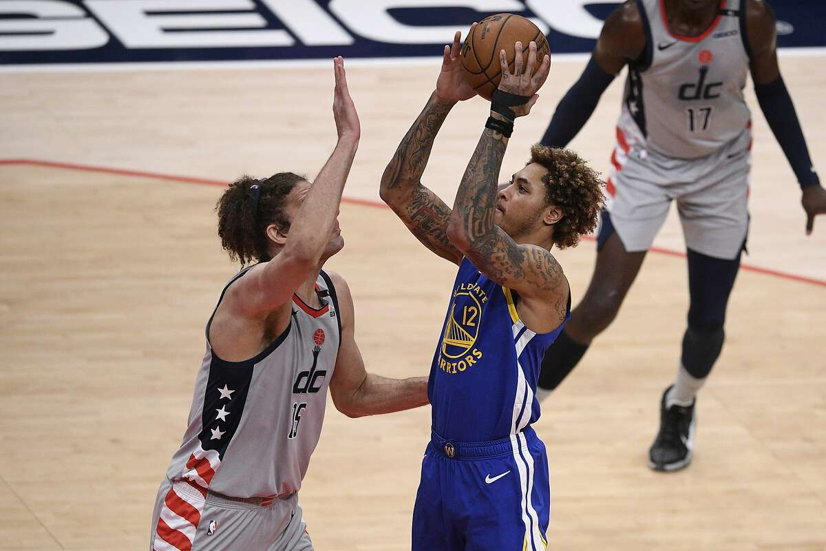 Golden State Warriors guard Kelly Oubre Jr. (12) goes to the basket against Washington Wizards center Robin Lopez (15) during the second half of an NBA basketball game, Wednesday, April 21, 2021, in Washington. (AP Photo/Nick Wass)
