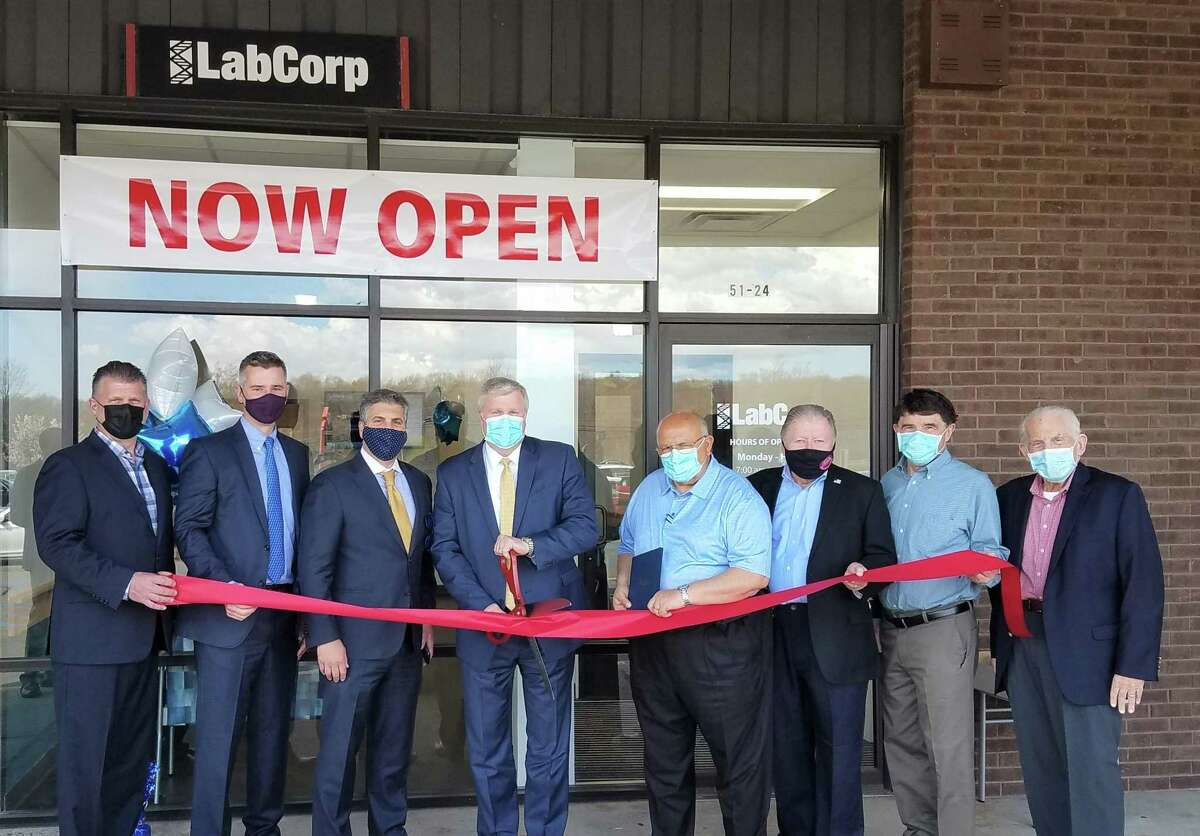 LabCorp of Cromwell held a grand opening April 14. From left are Middlesex County Chamber of Commerce Cromwell Division Chairman Rodney Bitgood, Regional Manager of Business Development of the Connecticut Division Brian Bartel, Associate Vice President, FQHC Northeast Diagnostics, Joe Palughi; LabCorp Vice President Ken Sprague, Town Manager Anthony Salvatore, Chamber past chairman Jay Polke, Director of Planning and Development Stuart Popper, and Chamber President Larry McHugh.
